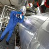 Technician using PPE while working with ammonia tank