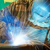 Welder working with electrode semiautomatic arc welding